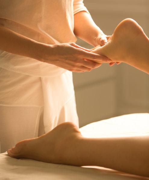 Foot massage at a spa centre.